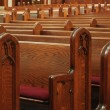 Empty church pews - Stock Photo
