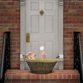 Baby on Doorstep — Stock Photo