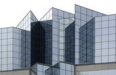 Angular glass office building exterior — Stock Photo