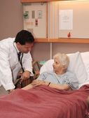 Attending to Senior Woman in Hospice — Stock Photo