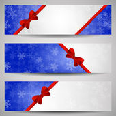 Three winter banners with snowflakes and red ribbon on blue, pla — Stock Vector
