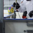Hockey players go out to the ice through the door — 图库视频影像