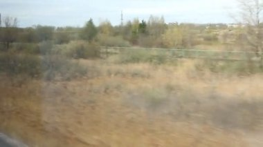 View from high-speed train window on the fields in spring — Stock Video