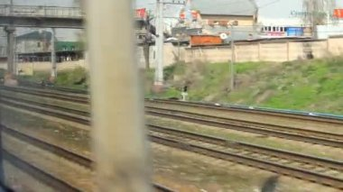 High-speed train moving a railway station — Stock Video