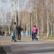 Stock Video: Young mother walking in a city park