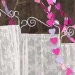 Stock Video: Decorations for artistic photo-shoot: White screen and garland of paper hearts