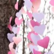 Fluttering in the wind garlands of paper hearts look upwards — Stock Video