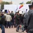 Stock Video: Riot police watching passing rally, Russia