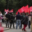 Stock Video: Column of protesters with red flags, Russia