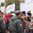 Stock Video: Riot police row watching passing political meeting, Russia