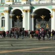 Stock Video: Tourists walking near Front gate of the Hermitage, St. Petersburg, Russia