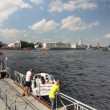 Stockvideo: Tour boat leaves from pier on Nevriver, St. Petersburg, Russia