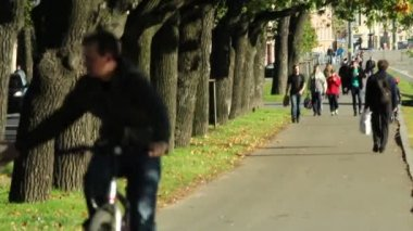 Man and woman riding a bike on alley — Stock Video