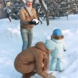 Royalty-Free Stock Vektorfiler: Young family throw up snow in the Air