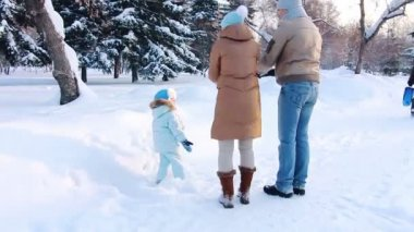 Young family throw up snow in the Air — Stock Video