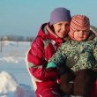 Stock Video: Portrait of young mother with baby in winter