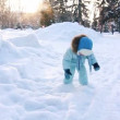 Stock Video: Child playing with snow in park (SLOW)