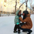 Stock Video: Mother and her little son on winter road