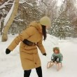 Young mother sledding her child in park — Stock Video
