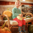 Little boy with pumpkins, proud boy — Stock Photo