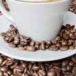Cappuccino and coffee beans — Stock Photo
