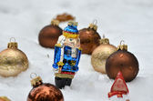 Nutcracker in snow — Stock Photo