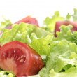 Wet tomatoes and lettuce salad — Stock Photo