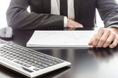 Businessman analyzing graph document — Stock Photo