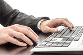 Businessman typing on keyboard — Stock Photo