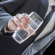 Business man offering a glass of water — Stock Photo