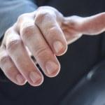 Detail of a man extending hand — Stock Photo