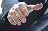Detail of a man extending hand — Stock Photo