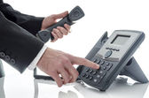 Male hand dialing number — Stock Photo