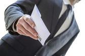Man giving envelope — Stock Photo
