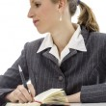 Pensive businesswoman at white desk — Stock Photo
