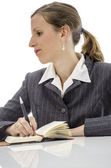 Pensive businesswoman at white desk — Stock Photo