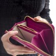 Woman holding an empty wallet — Stock Photo