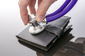 Checking a wallet with a stethoscope — Stock Photo