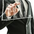 Business man pointing at graph — Stock Photo #22440235