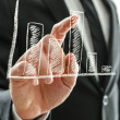Stock Photo: Businessman's hand pointing at graph