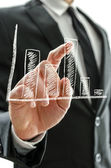 Businessman's hand pointing at graph — Stock Photo