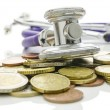 Stock Photo: Stethoscope over Euro coins