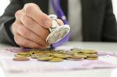 Businessman checking Euro money with stethoscope — Stock Photo