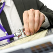 Close up of repairman holding stethoscope of laptop keyboard — Stock Photo