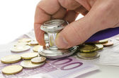 Stethoscope on European currency — Foto Stock