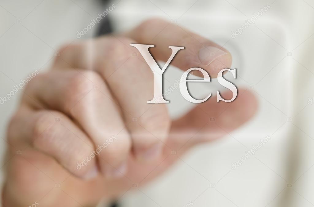 main dhomme daffaires touchant un bouton oui photographie gajus images 24154691. Black Bedroom Furniture Sets. Home Design Ideas