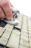 Stethoscope on an old laptop — Stock Photo