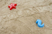Word holidays written in sand — Stock Photo