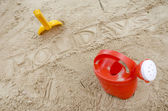 Wor holidays in sand with beach toys — Stock Photo