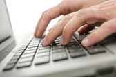 Businessman hands typing on laptop keyboard — Stock Photo